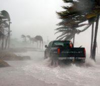 truck driving through hurricane wind